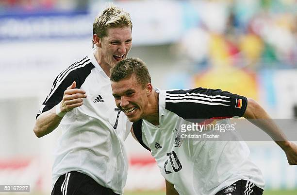 Bastian Schweinsteiger and Lukas Podolski of Germany celebrates the score to the first goal during the game between germany and Mexico for the third...