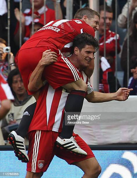Bastian Schweinsteiger and Mario Gomez of Bayern Muenchen celebrate Gomez' third goal during the Bundesliga match between FC Bayern Muenchen and...