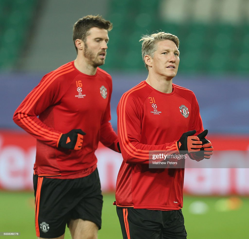 Bastian Schweinsteiger and Michael Carrick of Manchester United in action during a first team training session on the eve of their UEFA Champions...