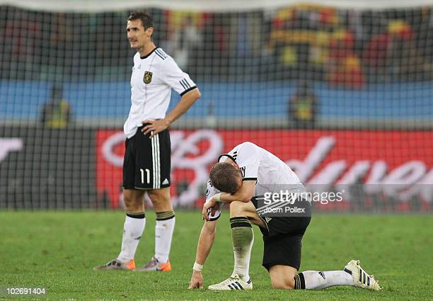 Bastian Schweinsteiger and Miroslav Klose of Germany show their dejection after being knocked out of the competition during the 2010 FIFA World Cup...
