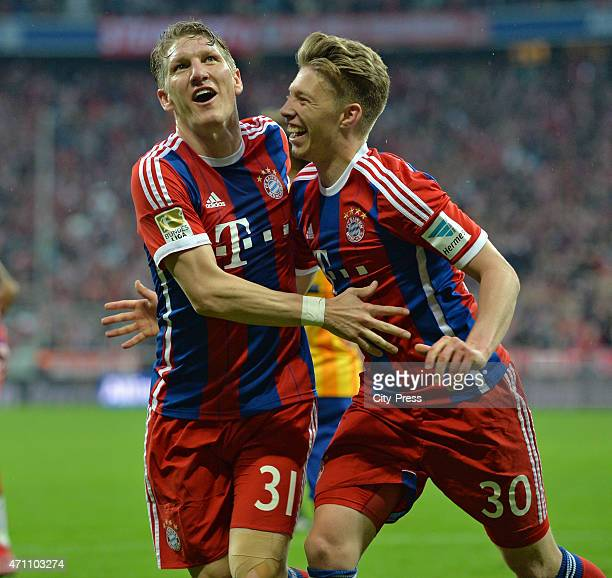Bastian Schweinsteiger and Mitchell Weiser of Bayern Muenchen celebrate after scoring the 10 during the game FC Bayern Muenchen against Hertha BSC on...