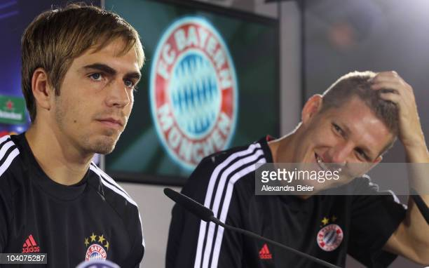 Bastian Schweinsteiger and Philipp Lahm of Bayern Muenchen answer journalists questions during a news conference ahead of the Champions League first...