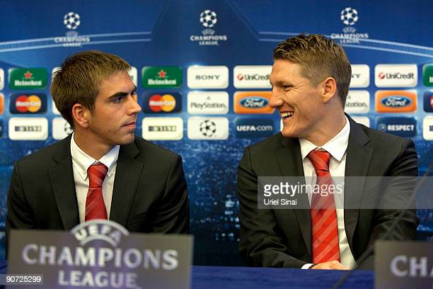 Bastian Schweinsteiger and Philipp Lahm of Bayern Muenchen are seen during a press conference ahead of their Champions League match against Macabi...