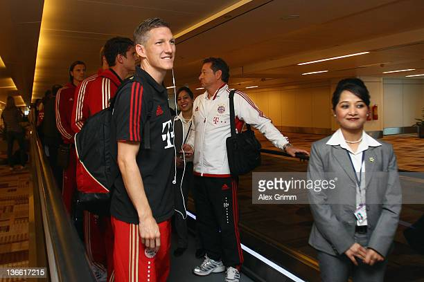 Bastian Schweinsteiger and team mates arrive at Delhi airport during the Bayern Muenchen training camp on January 9 2012 in Delhi India