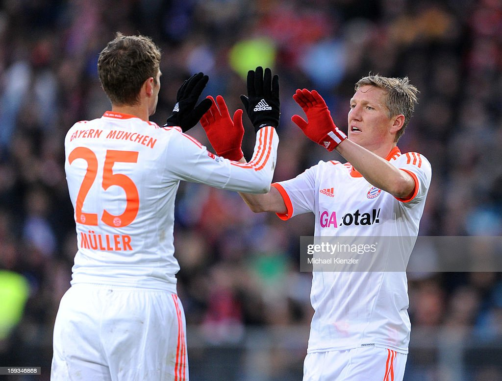 <a gi-track='captionPersonalityLinkClicked' href=/galleries/search?phrase=Bastian+Schweinsteiger&family=editorial&specificpeople=203122 ng-click='$event.stopPropagation()'>Bastian Schweinsteiger</a> (r) and <a gi-track='captionPersonalityLinkClicked' href=/galleries/search?phrase=Thomas+Mueller&family=editorial&specificpeople=5842906 ng-click='$event.stopPropagation()'>Thomas Mueller</a> of Bayern Munich celebrate Schweinsteiger's goal (2-0) during the friendly match between FC Basel and Bayern Munich at Stadium St. Jakob on January 12, 2013 in Basel, Switzerland.