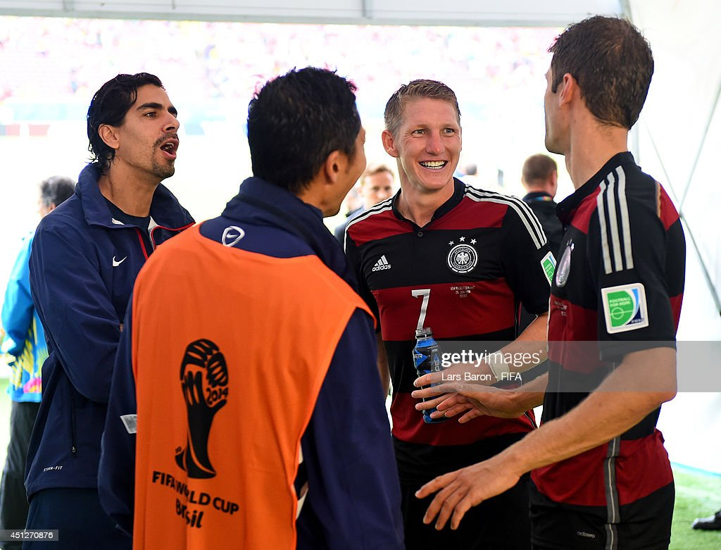 <a gi-track='captionPersonalityLinkClicked' href=/galleries/search?phrase=Bastian+Schweinsteiger&family=editorial&specificpeople=203122 ng-click='$event.stopPropagation()'>Bastian Schweinsteiger</a> (2nd R) and <a gi-track='captionPersonalityLinkClicked' href=/galleries/search?phrase=Thomas+Mueller&family=editorial&specificpeople=5842906 ng-click='$event.stopPropagation()'>Thomas Mueller</a> (1st R) of Germany talk in the tunnel after the 1-0 win in the 2014 FIFA World Cup Brazil Group G match between USA and Germany at Arena Pernambuco on June 26, 2014 in Recife, Brazil.