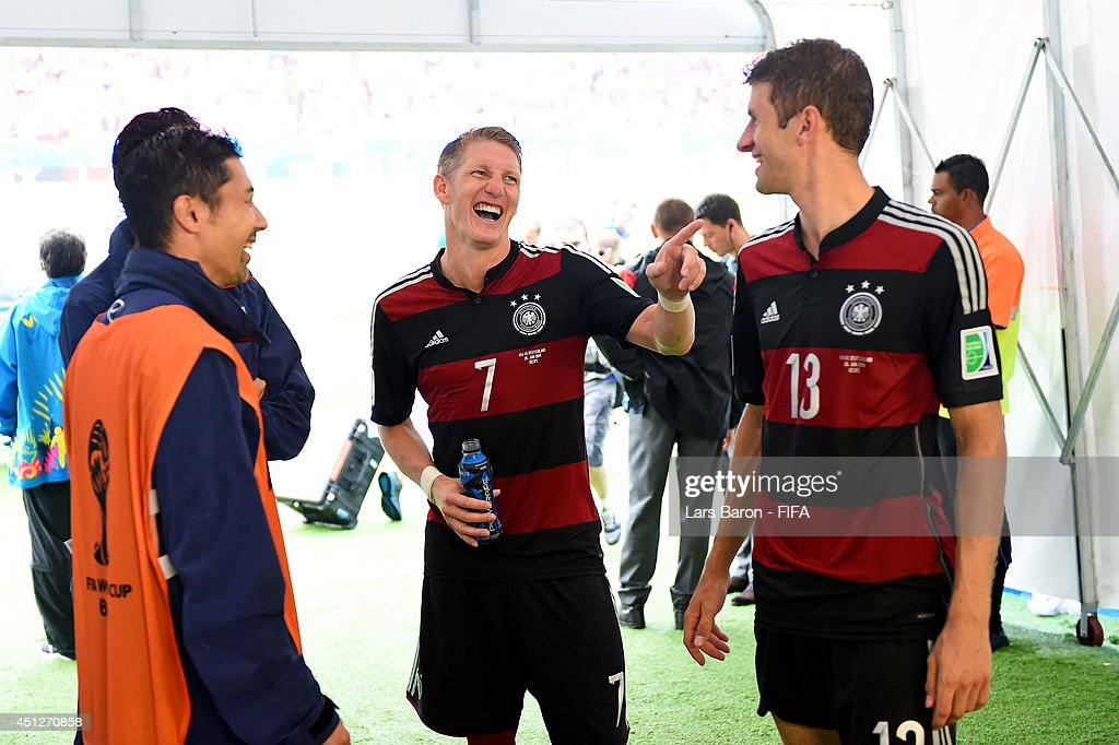 <a gi-track='captionPersonalityLinkClicked' href=/galleries/search?phrase=Bastian+Schweinsteiger&family=editorial&specificpeople=203122 ng-click='$event.stopPropagation()'>Bastian Schweinsteiger</a> (2nd R) and <a gi-track='captionPersonalityLinkClicked' href=/galleries/search?phrase=Thomas+Mueller&family=editorial&specificpeople=5842906 ng-click='$event.stopPropagation()'>Thomas Mueller</a> (1st R) of Germany walk in the tunnel after the 1-0 win in the 2014 FIFA World Cup Brazil Group G match between USA and Germany at Arena Pernambuco on June 26, 2014 in Recife, Brazil.