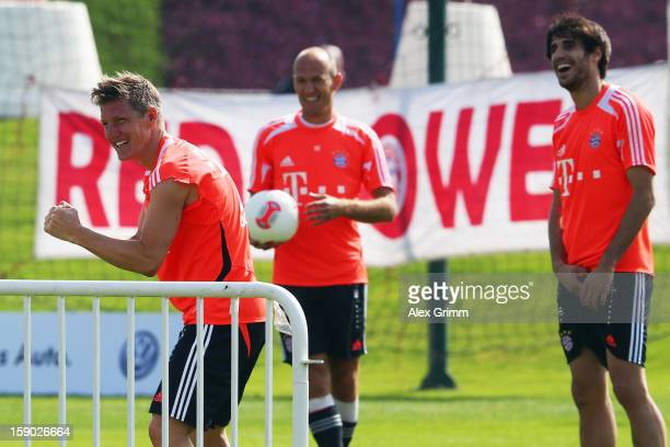 Bastian Schweinsteiger Arjen Robben and Javier Martinez react during a Bayern Muenchen training session at the ASPIRE Academy for Sports Excellence...