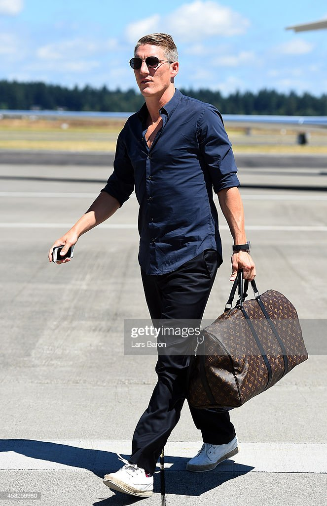 <a gi-track='captionPersonalityLinkClicked' href=/galleries/search?phrase=Bastian+Schweinsteiger&family=editorial&specificpeople=203122 ng-click='$event.stopPropagation()'>Bastian Schweinsteiger</a> arrives at the airport during day eight of the Bayern Muenchen Audi Summer Tour USA 2014 on August 6, 2014 in Portland, United States.