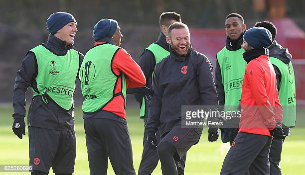 Bastian Schweinsteiger Ashley Young Wayne Rooney and Juan Mata of Manchester United in action during a first team training session at Aon Training...