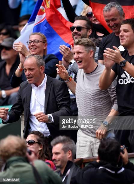 Bastian Schweinsteiger boyfriend of Ana Ivanovic celebrates victory after her Women's QuaterFinal match against Elina Svitolina on day ten of the...