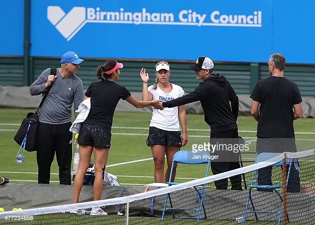 Bastian Schweinsteiger chats with girlfriend Ana Ivanovic of Serbia during a practise session on day one of the Aegon Classic at Edgbaston Priory...