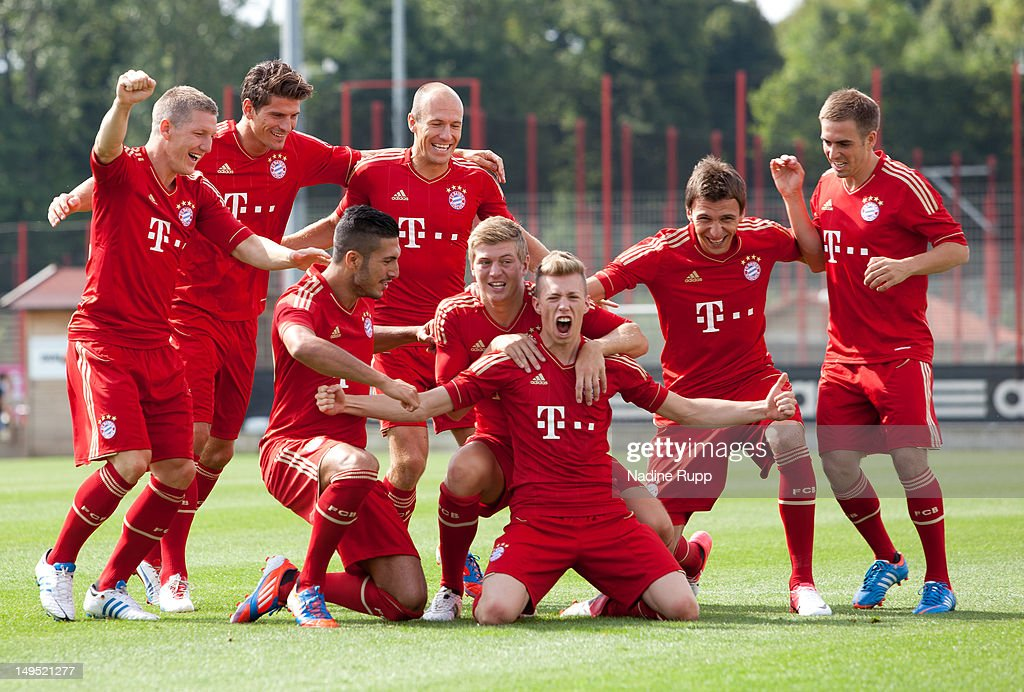 Bastian Schweinsteiger, Emre Can, Patrick Weisser, Mario Mandzukic, Philipp Lahm and Arjen Robben pose for a picture during the Bayern Muenchen team presentation at Bayern's training ground Saebener Strasse on July 30, 2012 in Munich, Germany.