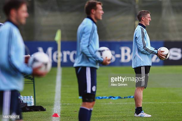 Bastian Schweinsteiger Holger Badstuber and Heiko Westermann attend a Germany training session ahead of their FIFA 2014 World Cup group C qualifying...