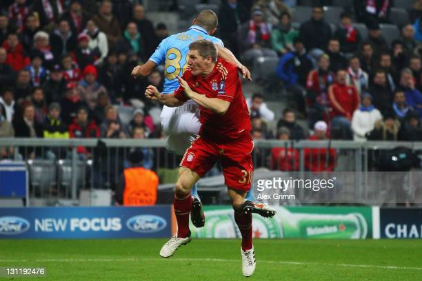 Bastian Schweinsteiger is hurt by Goekhan Inler of Napoli during the UEFA Champions League group A match between FC Bayern Muenchen and SSC Napoli at...