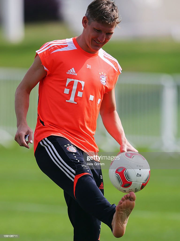 <a gi-track='captionPersonalityLinkClicked' href=/galleries/search?phrase=Bastian+Schweinsteiger&family=editorial&specificpeople=203122 ng-click='$event.stopPropagation()'>Bastian Schweinsteiger</a> juggles with the ball during a Bayern Muenchen training session at the ASPIRE Academy for Sports Excellence on January 8, 2013 in Doha, Qatar.