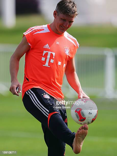 Bastian Schweinsteiger juggles with the ball during a Bayern Muenchen training session at the ASPIRE Academy for Sports Excellence on January 8 2013...
