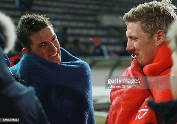Bastian Schweinsteiger of Bayern and his Tobias Schweinsteiger of Unterhaching chat together after the friendly game between FC Bayern Munich and...