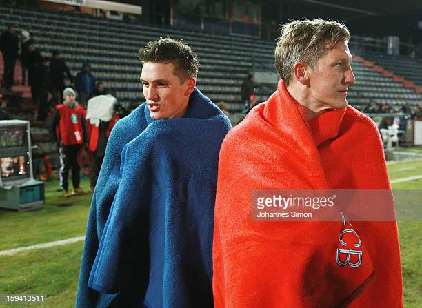 Bastian Schweinsteiger of Bayern and his Tobias Schweinsteiger of Unterhaching leave the pitch after the friendly game between FC Bayern Munich and...