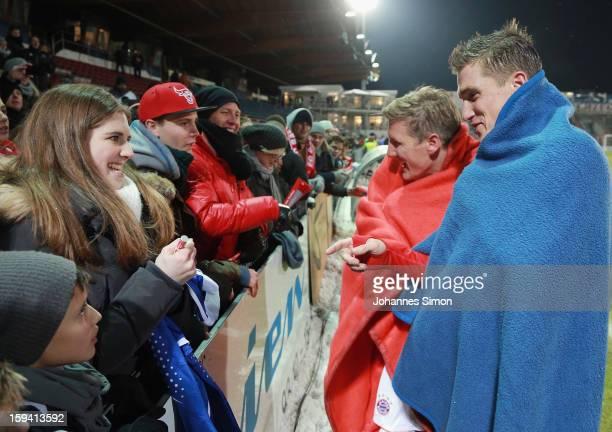 Bastian Schweinsteiger of Bayern and his Tobias Schweinsteiger of Unterhaching chat with friends after the friendly game between FC Bayern Munich and...