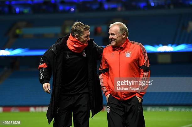 Bastian Schweinsteiger of Bayern and Muenchen Hermann Gerland the assistant coach of Bayern Muenchen inspect the pitch on arrival at the stadium...