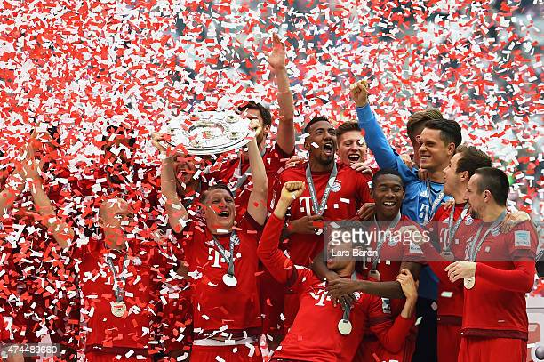 Bastian Schweinsteiger of Bayern Muenchen and teammates celebtrate with the trophy following the Bundesliga match between FC Bayern Muenchen and 1...