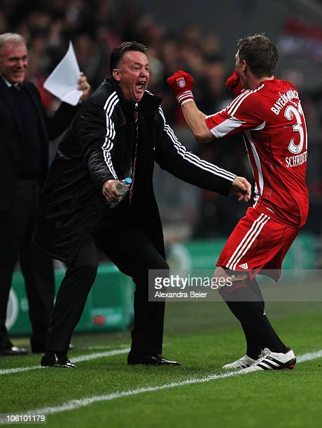 Bastian Schweinsteiger of Bayern Muenchen celebrates his second goal with team coach Louis van Gaal during the DFB Cup second round match between FC...