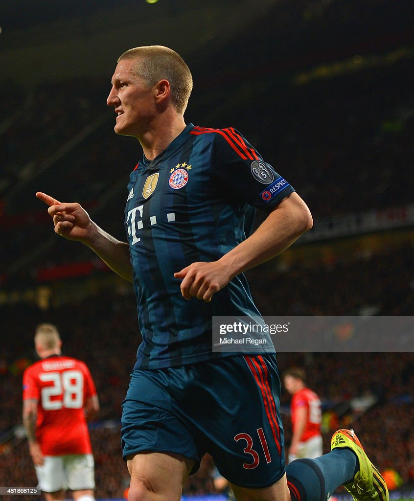 Bastian Schweinsteiger of Bayern Muenchen celebrates scoring their first goal during the UEFA Champions League Quarter Final first leg match between Manchester United and FC Bayern Muenchen at Old Trafford on April 1, 2014 in Manchester, England.