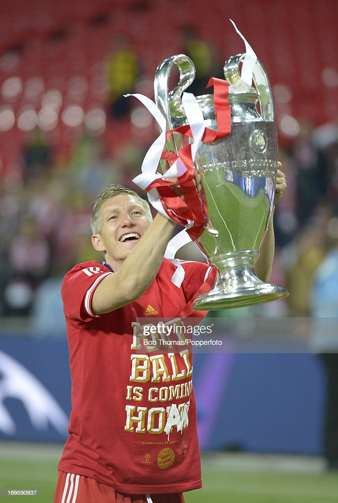 Bastian Schweinsteiger of Bayern Muenchen celebrates with the trophy after the UEFA Champions League final match between Borussia Dortmund and FC Bayern Muenchen at Wembley Stadium on May 25, 2013 in London, United Kingdom. Bayern Muenchen won the match 2-1.