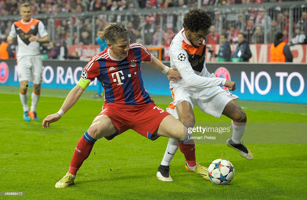 <a gi-track='captionPersonalityLinkClicked' href=/galleries/search?phrase=Bastian+Schweinsteiger&family=editorial&specificpeople=203122 ng-click='$event.stopPropagation()'>Bastian Schweinsteiger</a> (L) of Bayern Muenchen challenges <a gi-track='captionPersonalityLinkClicked' href=/galleries/search?phrase=Luiz+Adriano&family=editorial&specificpeople=4075604 ng-click='$event.stopPropagation()'>Luiz Adriano</a> of Shakhtar Donetsk during the UEFA Champions League Round of 16 second leg match between FC Bayern Muenchen and FC Shakhtar Donetsk at Allianz Arena on March 11, 2015 in Munich, Germany.