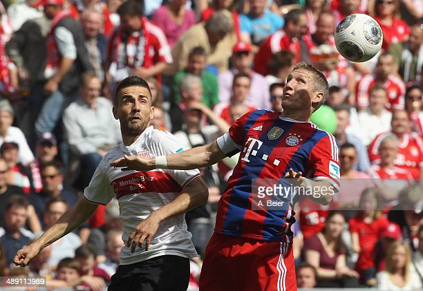 Bastian Schweinsteiger of Bayern Muenchen fights for the ball with Vedad Ibisevic of Stuttgart during the Bundesliga match between FC Bayern Muenchen...