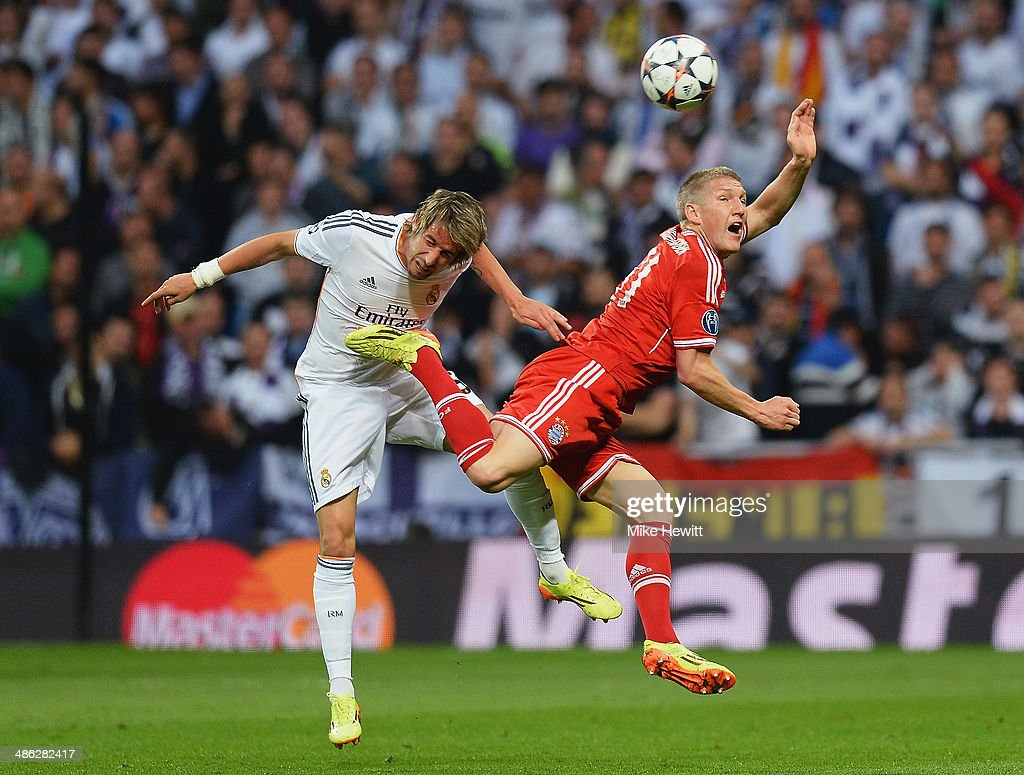 <a gi-track='captionPersonalityLinkClicked' href=/galleries/search?phrase=Bastian+Schweinsteiger&family=editorial&specificpeople=203122 ng-click='$event.stopPropagation()'>Bastian Schweinsteiger</a> of Bayern Muenchen is challenged by Fabio Coentrao of Real Madrid during the UEFA Champions League semi-final first leg match between Real Madrid and FC Bayern Muenchen at the Estadio Santiago Bernabeu on April 23, 2014 in Madrid, Spain.