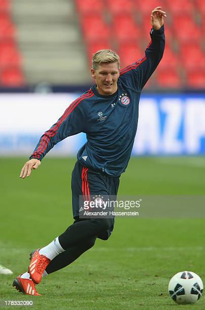 Bastian Schweinsteiger of Bayern Muenchen plays the ball during a training session prior the UEFA Super Cup finale match at Eden Arena on August 29...