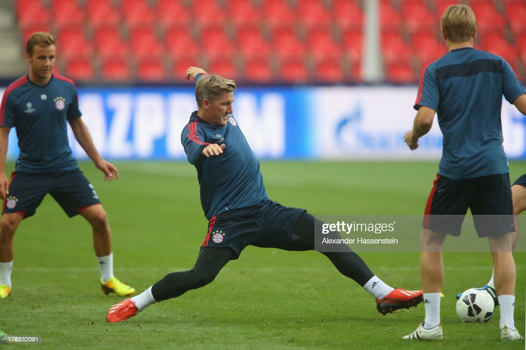 Bastian Schweinsteiger of Bayern Muenchen plays the ball during a training session prior the UEFA Super Cup finale match at Eden Arena on August 29, 2013 in Prague, Czech Republic. FC Bayern Muenchen will face Chelsea FC in the UEFA Super Cup Finale on the 30th of August.