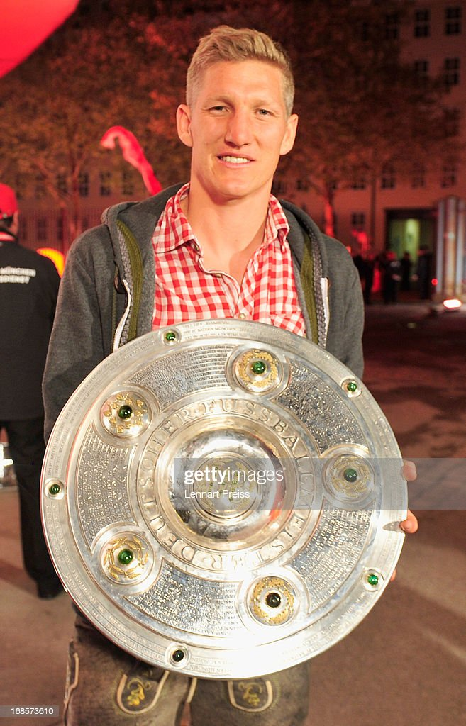 Bastian Schweinsteiger of Bayern Muenchen poses with the German football league champion's trophy prior to the the Official Champion dinner of Bayern Muenchen at Postpalast on May 12, 2013 in Munich, Germany.