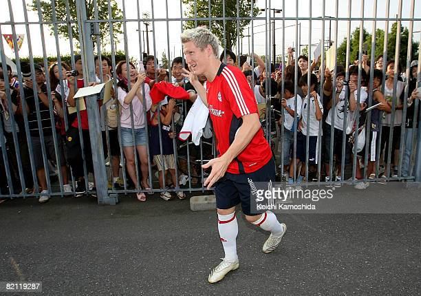 Bastian Schweinsteiger of Bayern Muenchen waves to Japanese fans during a practice session prior to the preseason match against Urawa Red Diamonds at...