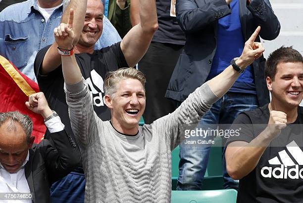 Bastian Schweinsteiger of Bayern Munchen celebrates the victory of his girlfriend Ana Ivanovic of Serbia during day 10 of the French Open 2015 at...