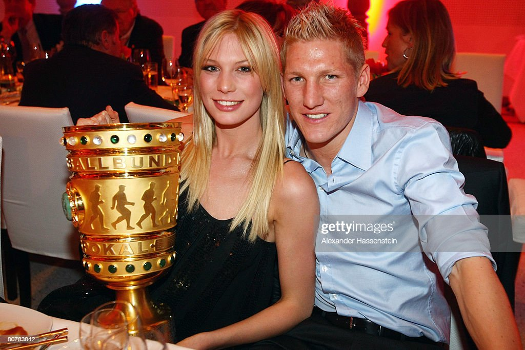 <a gi-track='captionPersonalityLinkClicked' href=/galleries/search?phrase=Bastian+Schweinsteiger&family=editorial&specificpeople=203122 ng-click='$event.stopPropagation()'>Bastian Schweinsteiger</a> of Bayern Munich and his girlfriend Sarah Brandner attend the Bayern Munich champions party after the DFB Cup Final match between Borussia Dortmund and FC Bayern Munich at the Deutsche Telekom Represantive House Berlin on April 20, 2008 in Berlin, Germany.