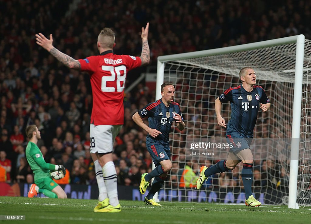 <a gi-track='captionPersonalityLinkClicked' href=/galleries/search?phrase=Bastian+Schweinsteiger&family=editorial&specificpeople=203122 ng-click='$event.stopPropagation()'>Bastian Schweinsteiger</a> of Bayern Munich celebrates scoring their first goal during the UEFA Champions League quarter-final first leg match between Manchester United and Bayern Munich at Old Trafford on April 1, 2014 in Manchester, England.