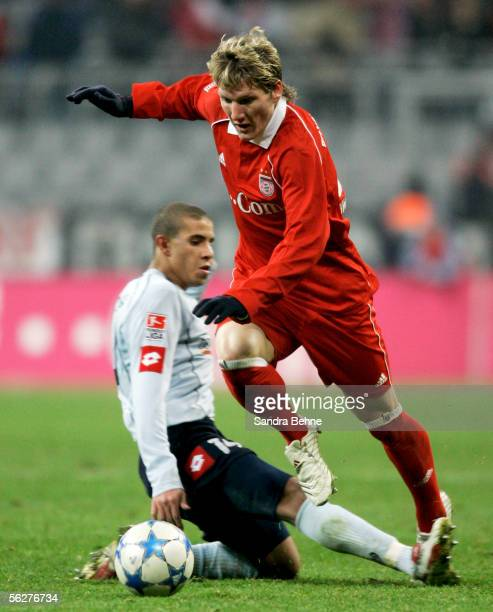 Bastian Schweinsteiger of Bayern Munich challenges Mohamed Zidan of Mainz during the Bundesliga match between Bayern Munich and FSV Mainz 05 at the...