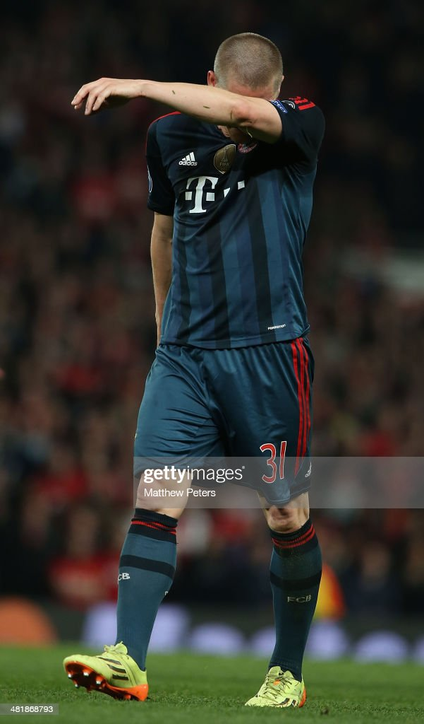 <a gi-track='captionPersonalityLinkClicked' href=/galleries/search?phrase=Bastian+Schweinsteiger&family=editorial&specificpeople=203122 ng-click='$event.stopPropagation()'>Bastian Schweinsteiger</a> of Bayern Munich reacts to being sent off during the UEFA Champions League quarter-final first leg match between Manchester United and Bayern Munich at Old Trafford on April 1, 2014 in Manchester, England.