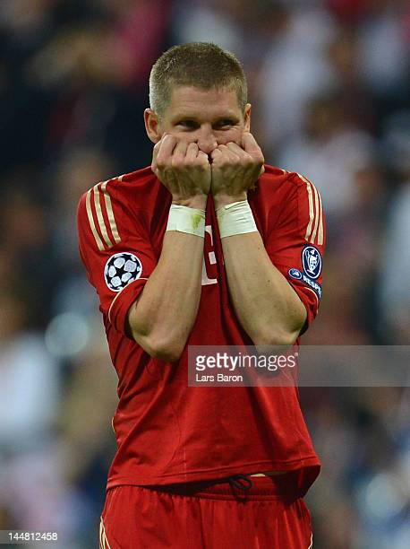 Bastian Schweinsteiger of Bayern reacts after failing to score in the penalty shoot out during UEFA Champions League Final between FC Bayern Muenchen...