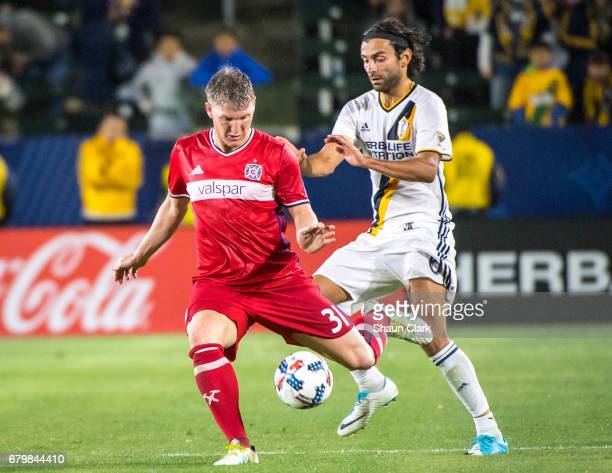 Bastian Schweinsteiger of Chicago Fire battles Baggio Husidic of Los Angeles Galaxy during the Los Angeles Galaxy's MLS match against Chicago Fire at...
