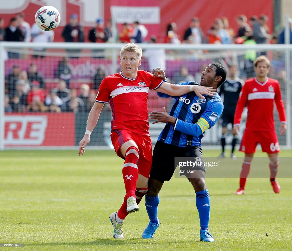 Bastian Schweinsteiger #31 of Chicago Fire battles for the ball with Patrice Bernier #8 of Montreal Impact during the first half at Toyota Park on April 1, 2017 in Bridgeview, Illinois. The match ended in a 2-2 draw.