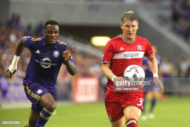 ORLANDO FL JUNE 4 Bastian Schweinsteiger of Chicago Fire chases down a loose ball in front of Cyle Larin of Orlando City SC during a MLS soccer match...