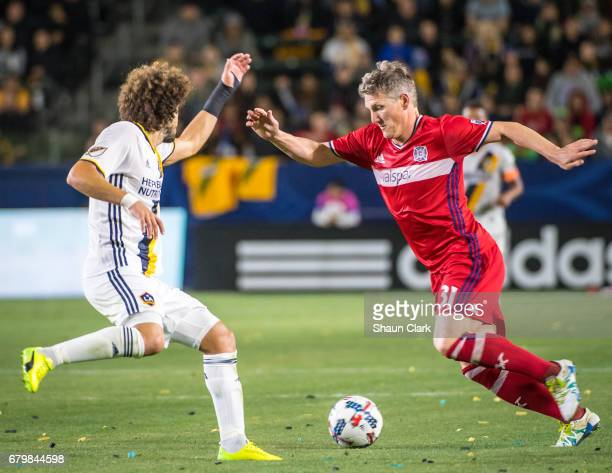 Bastian Schweinsteiger of Chicago Fire goes past Joao Pedro of Los Angeles Galaxy during the Los Angeles Galaxy's MLS match against Chicago Fire at...