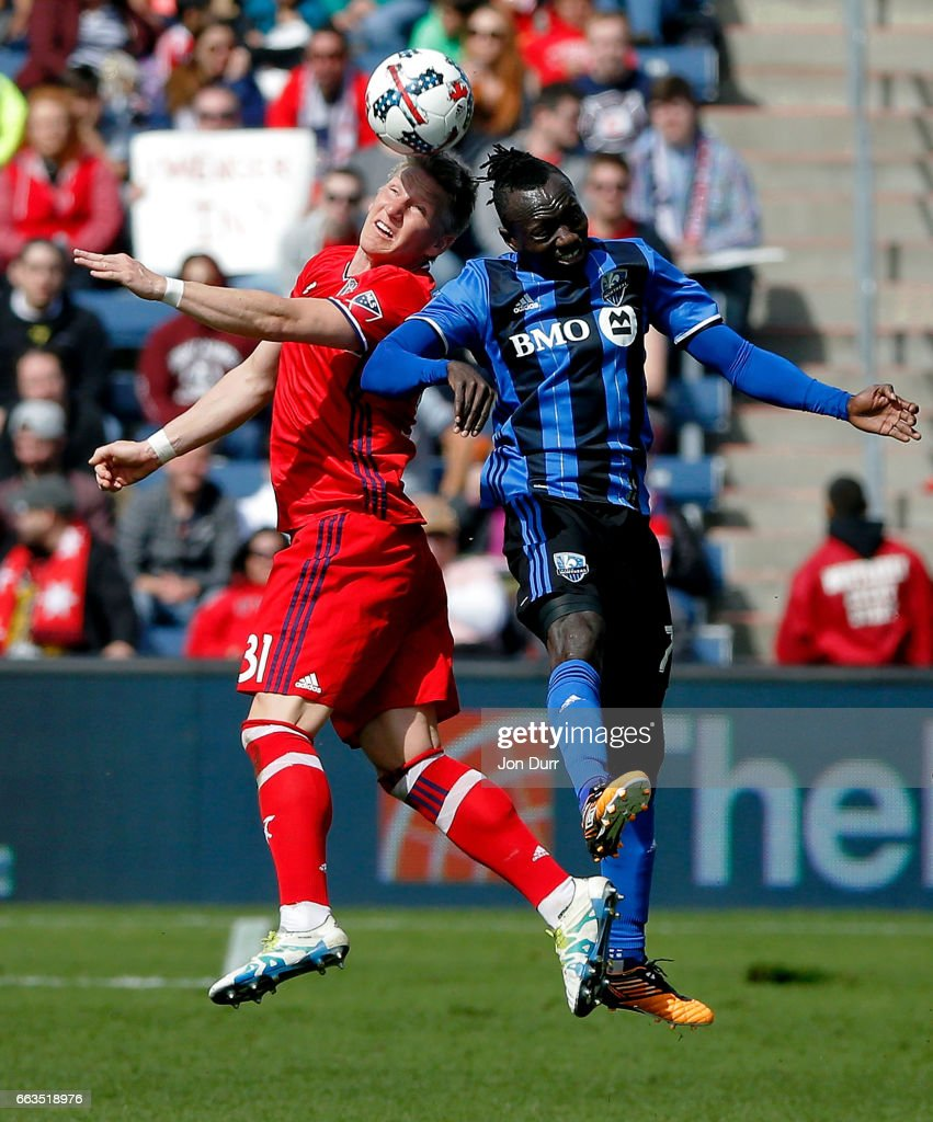 Bastian Schweinsteiger #31 of Chicago Fire goes up for a header against Dominic Oduro #7 of Montreal Impact during the first half at Toyota Park on April 1, 2017 in Bridgeview, Illinois.
