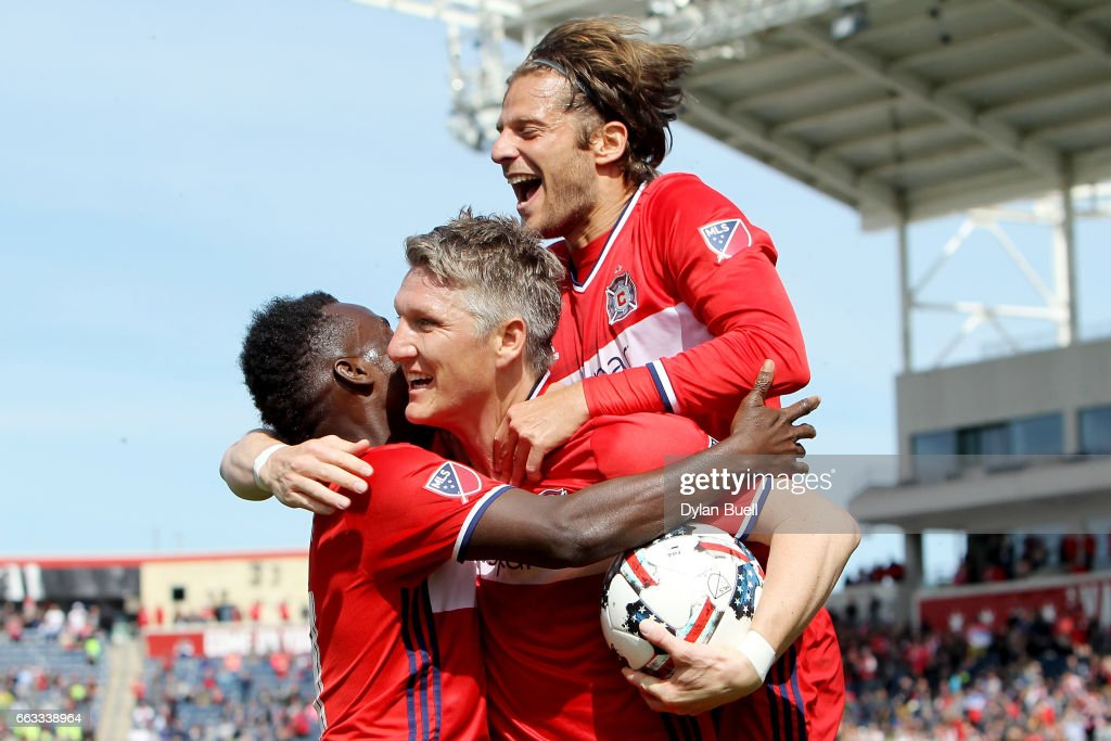 Bastian Schweinsteiger #31 of Chicago Fire is congratulated by David Accam #11 and Joao Meira #66 after scoring a goal in the first half against the Montreal Impact during an MLS match at Toyota Park on April 1, 2017 in Bridgeview, Illinois.