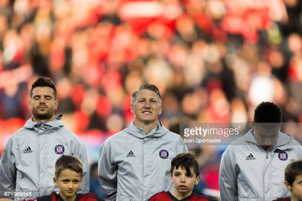 Bastian Schweinsteiger of Chicago Fire stands for the national anthem prior to an MLS Soccer regular season game between Toronto FC and Chicago Fire...