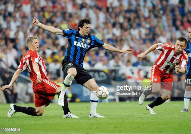 Bastian Schweinsteiger of FC Bayern Muenchen and Diego Milito of Inter Milan and Ivica Olic of FC Bayern Muenchen in action during the UEFA Champions...